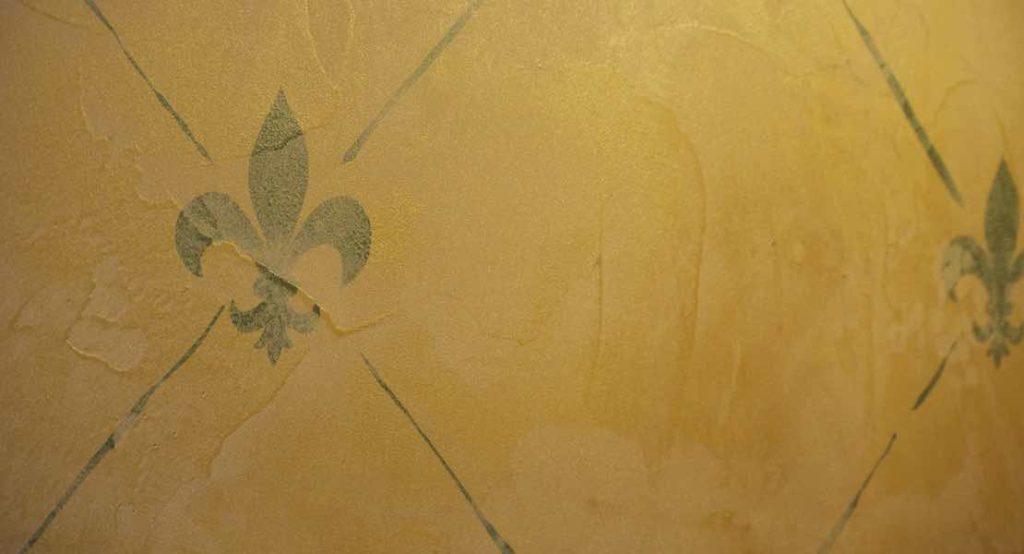 plaster with fleur de lis