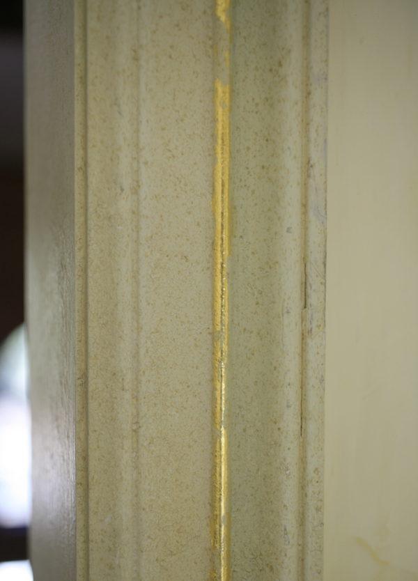 Gold leaf accent detail on trim
