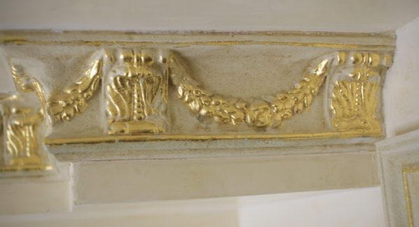 Gold leaf on plaster with blue