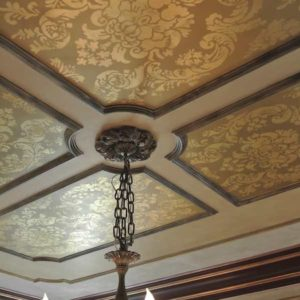 Gilded ornament in patterned ceiling panels