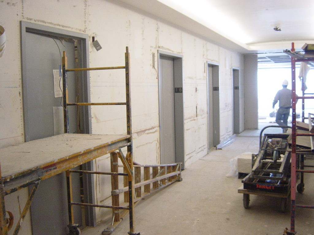 Elevator lobby under construction before paint